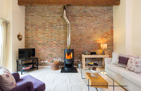 Hayloft lounge with woodburner
